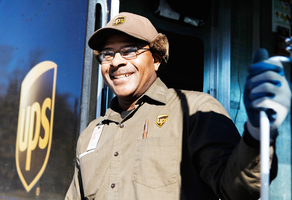 Photo - UPS driver Lowell Harkey is shown Monday in  Edmond.   Photo by Jim Beckel,  The Oklahoman