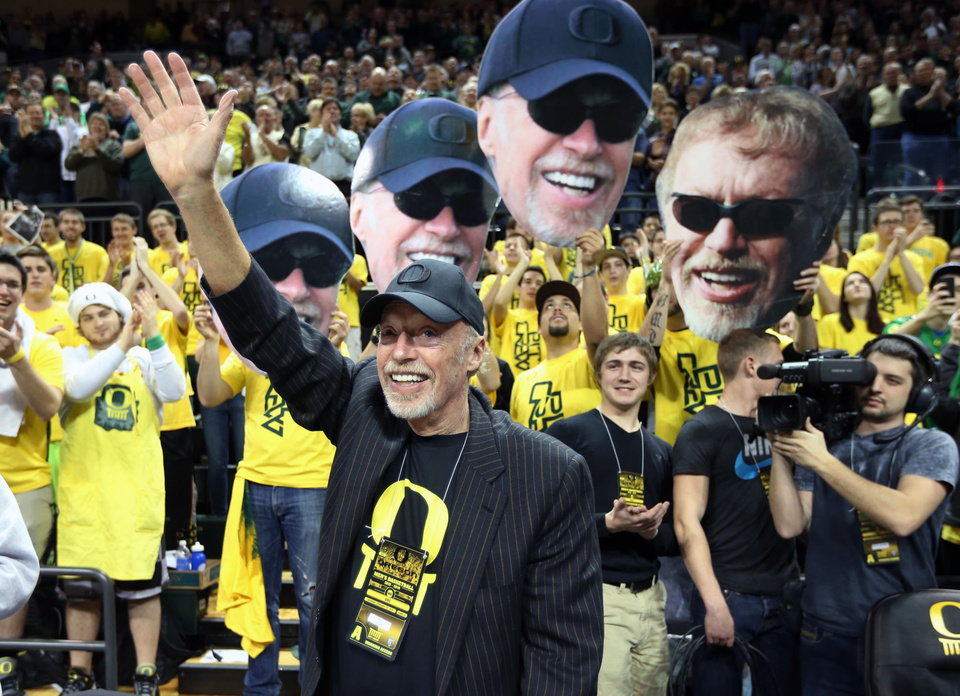 Photo - Nike founder and Oregon donor Phil Knight acknowledge the crowd on Uncle Phil Appreciation Night at Matthew Knight Arena during Oregon's basketball game against Southern California in an NCAA college basketball game in Eugene, Ore. on Saturday, Feb. 1, 2014. (AP Photo/Chris Pietsch)