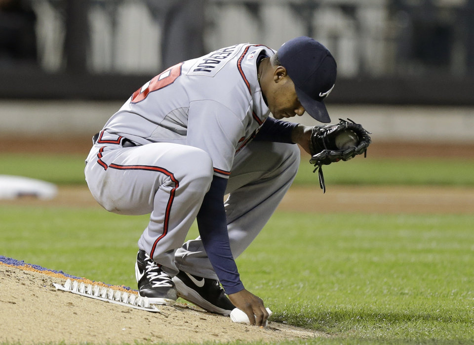 Atlanta Braves starting pitcher Julio Teheran (49) reacts on the mound after allowing a solo home run to New York Mets' Lucas Duda in the fourth inning of a baseball game at Citi Field in New York, Sunday, May 26, 2013. (AP Photo/Kathy Willens)
