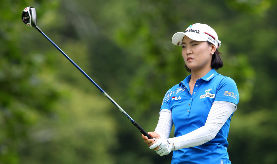 Photo - So Yeon Ryu, of South Korea, lines up her tee shot on the 11th hole at the Canadian Pacific Women's Open golf tournament in London, Ontario, Thursday, Aug. 21, 2014. (AP Photo/The Canadian Press, Dave Chidley)