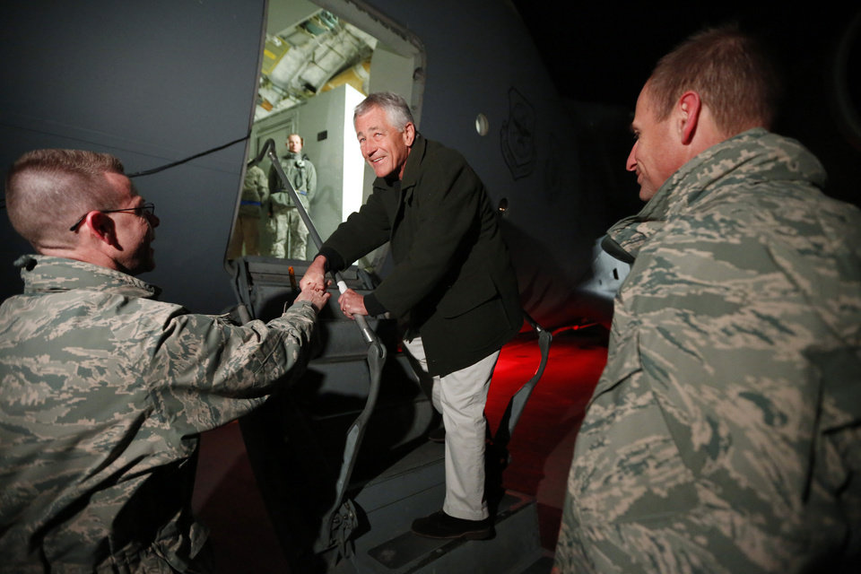 Photo - Defense Secretary Chuck Hagel steps aboard a C-17 military aircraft before departing from Manas Air Force Base, Kyrgyzstan, en route to Kabul Afghanistan, Friday, March 8, 2013. Hagel arrived in Afghanistan Friday for his first visit as Pentagon chief, saying that there are plenty of challenges ahead as NATO hands over the country's security to the Afghans.  (AP Photo/Jason Reed, Pool)