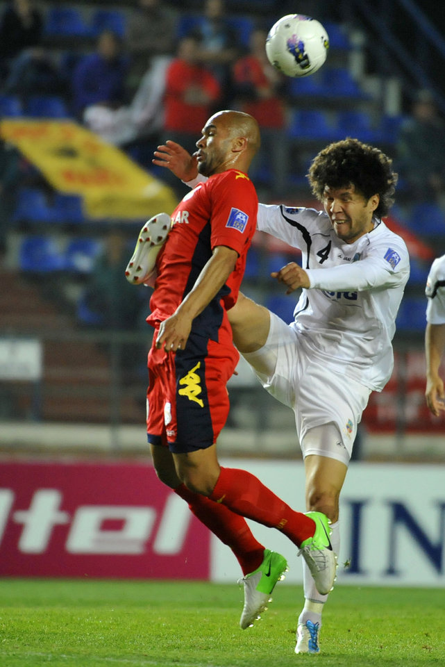 Adelaide United's Serginho Van Dijk, left, and Bunyodkor's Khayrulla Karimov jump for the ball during their 2012 AFC Champions League quarter-final second leg match in Tashkent, Uzbekistan, Wednesday, Oct. 3, 2012. (AP Photo/Anvar Ilyasov)