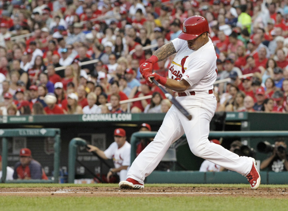 Photo - St. Louis Cardinals' Kolten Wong (16) connects for a two-RBI double in the second inning of a baseball game against the Pittsburgh Pirates, Tuesday, July 8, 2014, in St. Louis. (AP Photo/Tom Gannam)