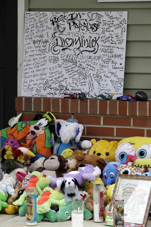 Photo -   A makeshift memorial for the slain Dominick Andujar sets on his front porch, Tuesday, Sept. 4, 2012, in Camden, N.J. Authorities say 31-year-old Osvaldo Rivera killed 6-year-old Andujar and critically injured his 12-year-old sister in Camden early Sunday. (AP Photo/Matt Rourke)