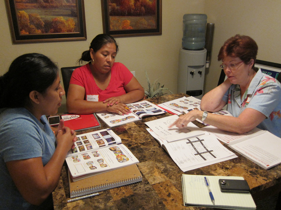 Photo -    Linda Dorman, right, teaches an advanced class in English as a second language to residents at Oak Ridge Estates.
