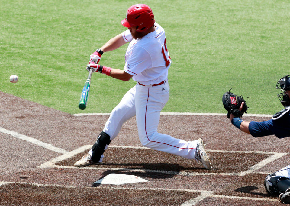Photo - Louisiana-Lafayette's Jace Conrad hits a grand slam in the second inning during an NCAA college baseball tournament regional game against Jackson State, Sunday, June 1, 2014, in Lafayette, La. (AP Photo/Jonathan Bachman)