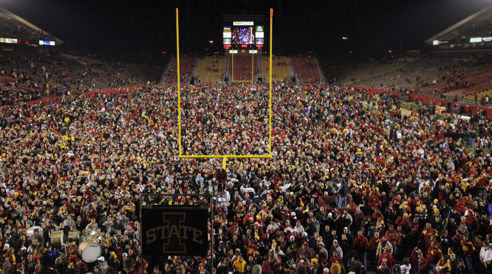 Photo - CROWD: Iowa State fans flood the field after a college football game between the Oklahoma State University Cowboys (OSU) and the Iowa State University Cyclones (ISU) at Jack Trice Stadium in Ames, Iowa, Saturday, Nov. 19, 2011. Iowa State won, 37-31, in double overtime. Photo by Nate Billings, The Oklahoman