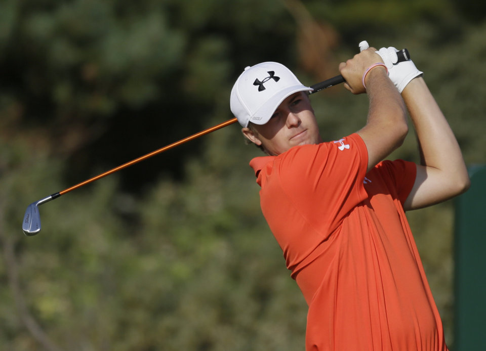 Photo - Jordan Spieth of the United States plays a shot off the third tee during the second round of the British Open Golf Championship at Muirfield, Scotland, Friday July 19, 2013. (AP Photo/Jon Super)