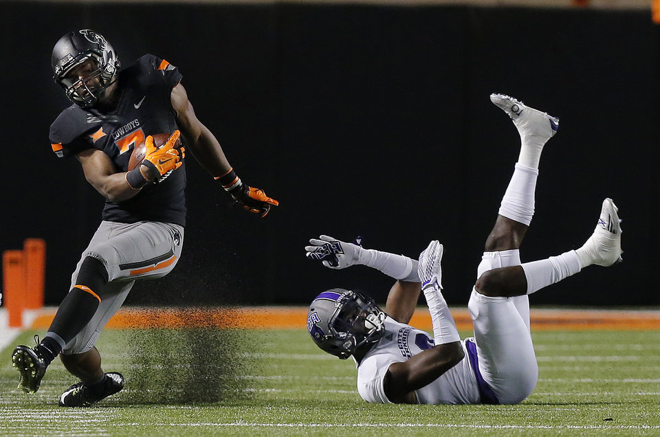 Photo - Oklahoma State's Brandon Sheperd (7) gets by Central Arkansas's Tyler Williams (9) during the college football game between the Oklahoma State Cowboys (OSU) and the Central Arkansas Bears at Boone Pickens Stadium in Stillwater, Okla., Saturday, Sept. 12, 2015. Photo by Sarah Phipps, The Oklahoman