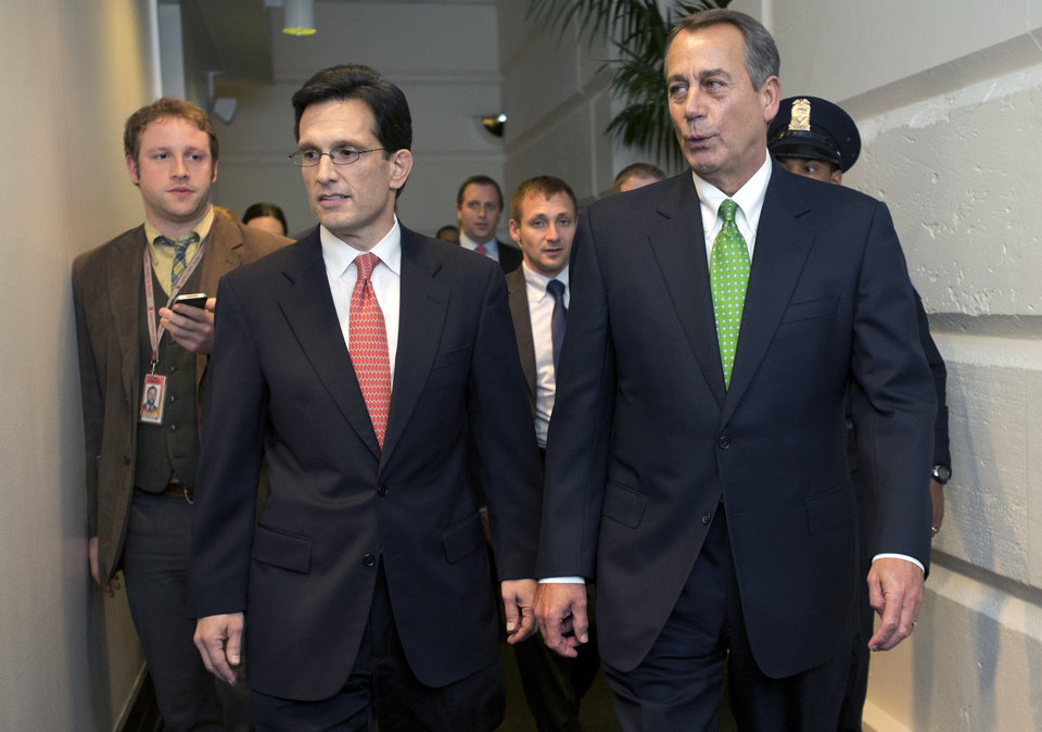 Photo - House Majority Leader Eric Cantor, R-Va., left, and Speaker of the House John Boehner, R-Ohio, arrive to a second Republican caucus meeting at the U.S. Capitol in Washington, on Tuesday, Jan. 1, 2013. (AP Photo/Jacquelyn Martin)