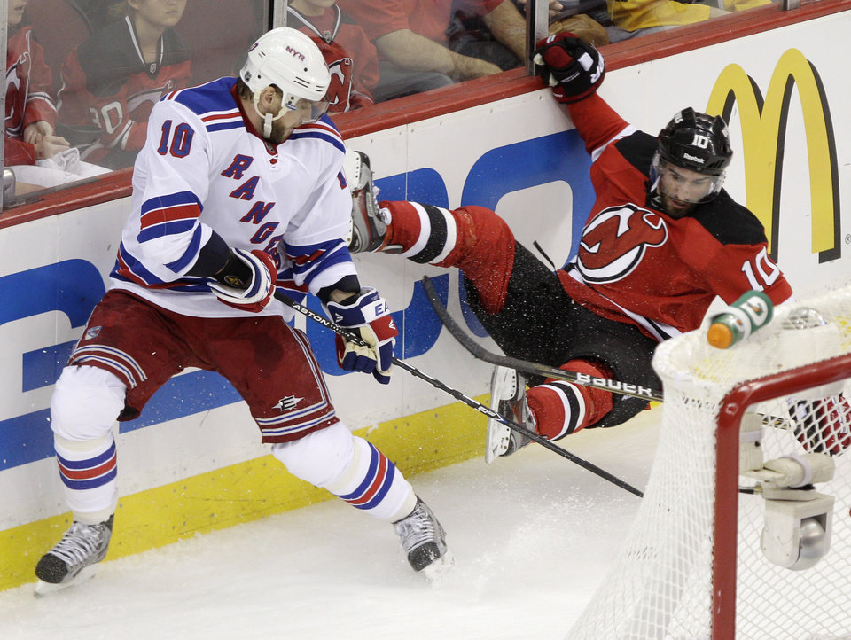 Photo -   New York Rangers right wing Marian Gaborik, left, of Slovakia, collides with New Jersey Devils defenseman Peter Harrold during the first period of Game 3 of an NHL hockey Stanley Cup Eastern Conference final playoff series, Saturday, May 19, 2012, in Newark, N.J. (AP Photo/Frank Franklin II)