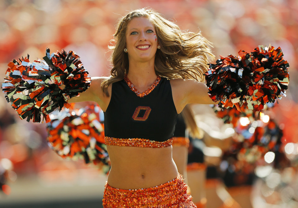 Photo - A member of the OSU pom squad dances during a college football game between Oklahoma State University (OSU) and Iowa State University (ISU) at Boone Pickens Stadium in Stillwater, Okla., Saturday, Oct. 20, 2012. OSU won, 31-10. Photo by Nate Billings, The Oklahoman