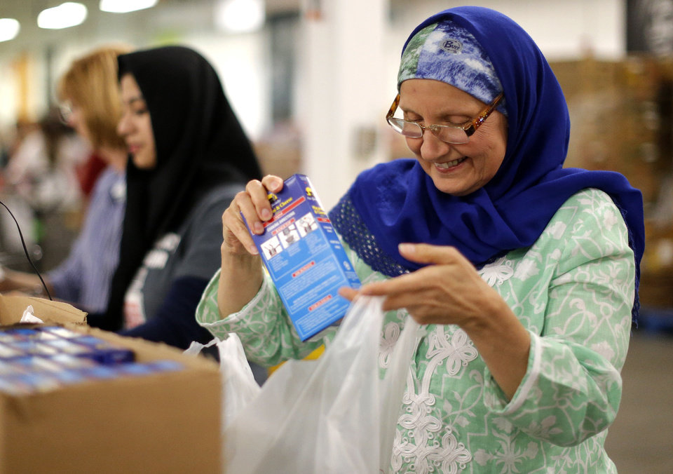 Sheryl Siddiqui packages food while volunteering the fasting hours of Ramadan at the Regional Food Bank of Oklahoma ,Saturday, July 27,  2013, in Oklahoma City. About 150 Muslims from various  organizations from across the state volunteered. Photo by Sarah Phipps, The Oklahoman