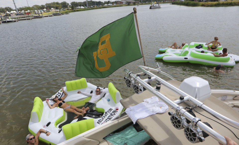 Photo - Baylor fans lounge on the Brazos River outside new McLane Stadium before the NCAA college football game between SMU and Baylor, Sunday, Aug. 31, 2014, in Waco, Texas. (AP Photo/LM Otero)