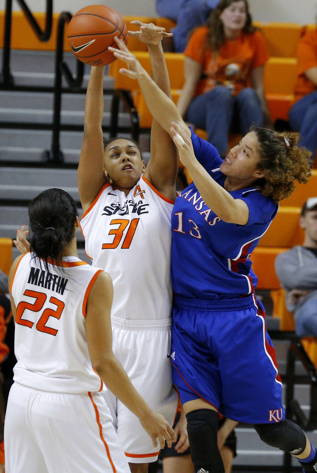Photo - Kansas' Monica Engelman (13) tries to pass the ball around Oklahoma State's Kendra Suttles (31) and Brittney Martin (22) during a women's college basketball game between Oklahoma State University (OSU) and Kansas at Gallagher-Iba Arena in Stillwater, Okla., Tuesday, Jan. 8, 2013. Oklahoma State won 76-59. Photo by Bryan Terry, The Oklahoman