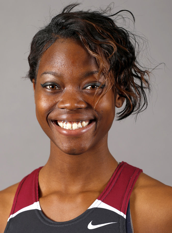 Photo - Shaquan Burris of the Edmond Memorial girls track team poses for a mug during the spring high school sports photo day in Oklahoma City, Wed. Feb. 27, 2013. Photo by Bryan Terry, The Oklahoman