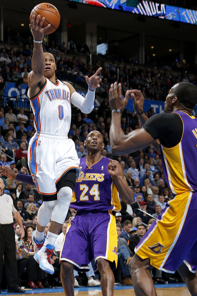 Oklahoma City\'s Russell Westbrook (0) goes past Los Angeles\' Kobe Bryant (24) and Dwight Howard (12) during an NBA basketball game between the Oklahoma City Thunder and the Los Angeles Lakers at Chesapeake Energy Arena in Oklahoma City, Tuesday, March. 5, 2013. Photo by Bryan Terry, The Oklahoman
