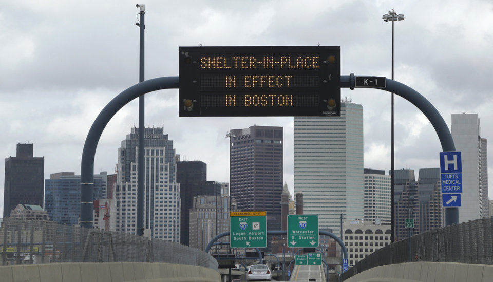 Photo - A sign calling for citizens of Boston to