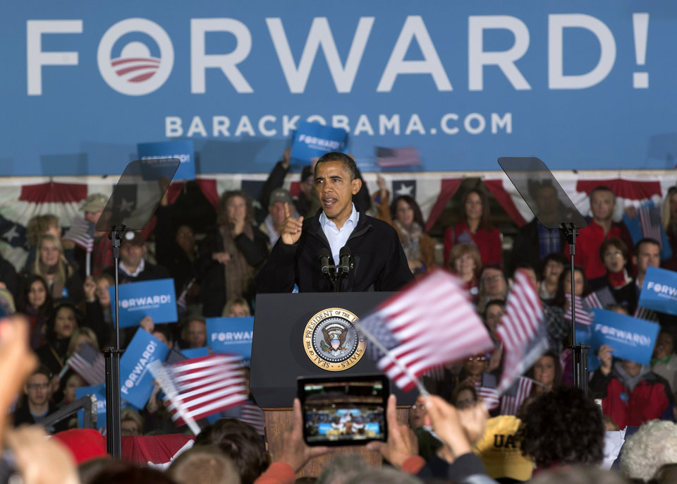 Photo -   President Barack Obama gestures as he speaks at a campaign event at the Franklin County Fairgrounds, Friday, Nov. 2, 2012, in Hilliard, Ohio, before heading to another campaign stop in in Springfield, Ohio. (AP Photo/Carolyn Kaster)
