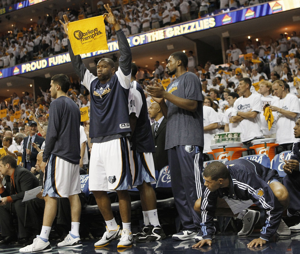 Photo - Memphis Grizzlies players celebrate in the overtime period against the Oklahoma City Thunder in Game 3 of a second-round NBA basketball series on Saturday, May 7, 2011, in Memphis, Tenn. The Grizzlies won 101-93 in overtime to take a 2-1 lead in the series. From left are Greivis Vasquez, Sam Young, Leon Powe, and Shane Battier. (AP Photo/Mark Humphrey)