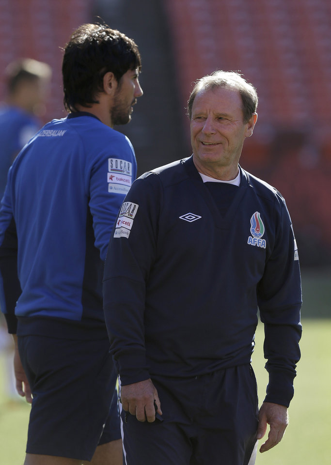 Photo - Azerbaijan soccer head coach Berti Vogts, right, watches as his team begins practice at Candlestick Park in San Francisco, Sunday, May 25, 2014. (AP Photo/Jeff Chiu)