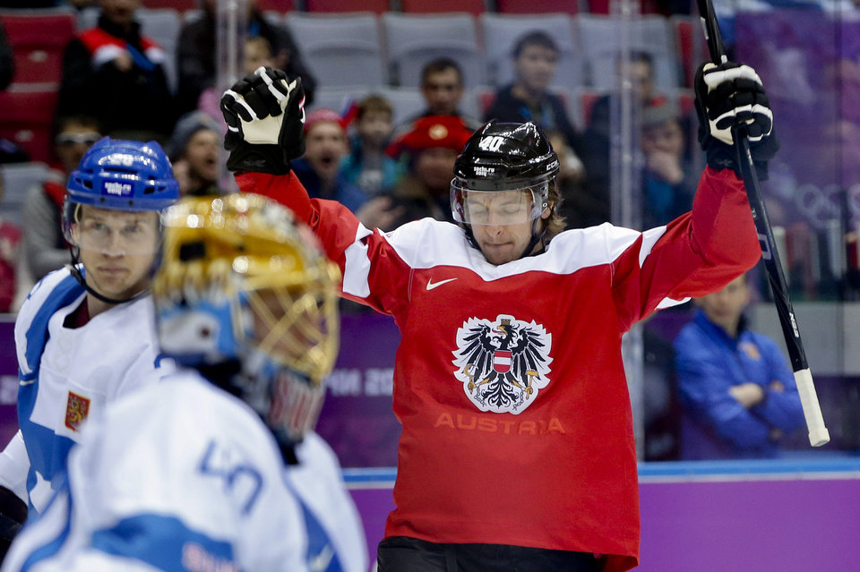 Photo - Austria forward Michael Rene Grabner reacts after scoring a goal against Finland in the first period of a men's ice hockey game at the 2014 Winter Olympics, Thursday, Feb. 13, 2014, in Sochi, Russia. (AP Photo/Julio Cortez)