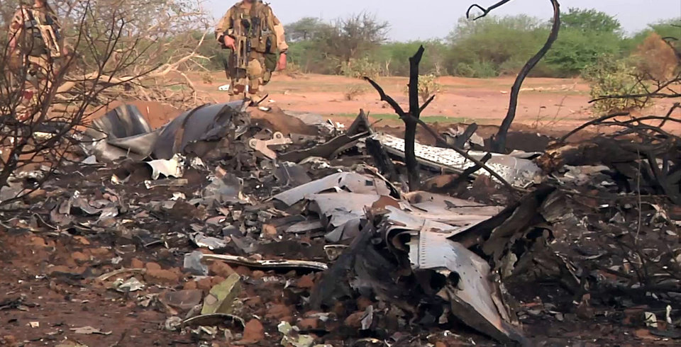 Photo - This photo provided Friday July 25, 2014 by the French army shows soldiers at the site of the plane crash in Mali. French soldiers secured a black box from the Air Algerie wreckage site in a desolate region of restive northern Mali on Friday, the French president said. Terrorism hasn't been ruled out as a cause, although officials say the most likely reason for the catastrophe that killed all onboard is bad weather. At least 116 people were killed in Thursday's disaster, nearly half of whom were French. (AP Photo/ECPAD)