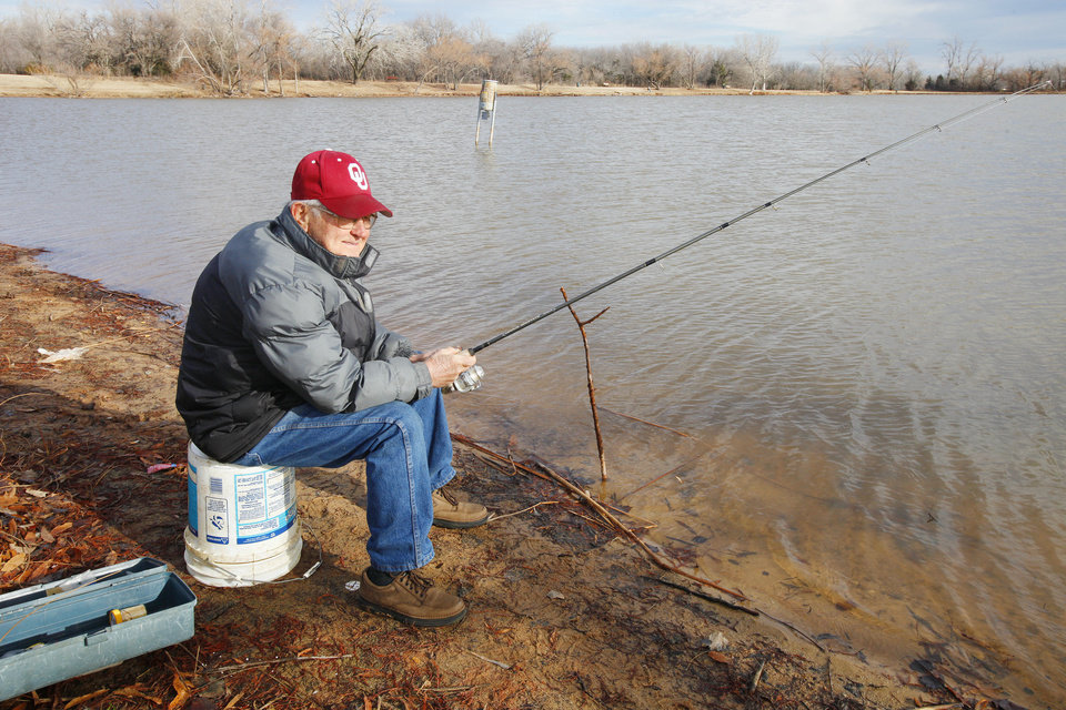 Above: L.D. Brandon, of Midwest City, fishes for trout at Dolese Youth Park Pond in Oklahoma City.