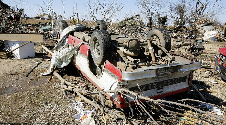 Photo - Debris from mobile homes and vehicles on Brock Road in Lone Grove, Wednesday, Feb. 11, 2009.  BY PAUL B. SOUTHERLAND, THE OKLAHOMAN