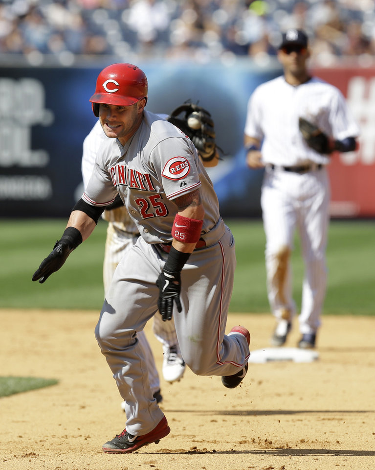 Photo - Cincinnati Reds' Skip Schumaker reacts while caught in a run-down during the eighth inning of the game against the New York Yankees at Yankee Stadium Sunday, July 20, 2014 in New York. (AP Photo/Seth Wenig)