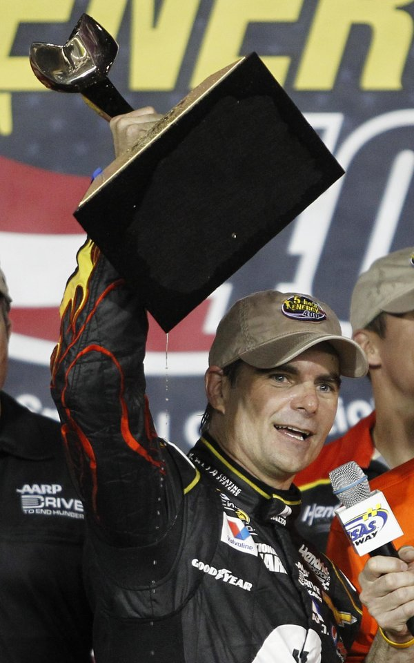 Photo - NASCAR driver Jeff Gordon celebrates in victory lane after winning the Sprint Cup Series auto race at Kansas Speedway in Kansas City, Kan., Saturday, May 10, 2014. (AP Photo/Colin E. Braley)