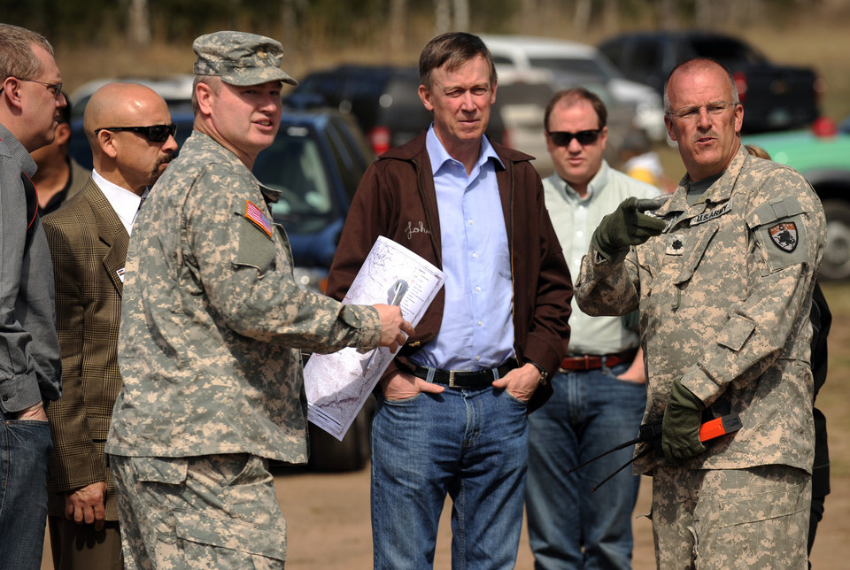 Photo -   Colorado Gov. John Hickenlooper arrives on the scene of the Lower North Fork fire area in Conifer, Colo., on Thursday, March 29, 2012, where a wildfire broke out on Monday. The fire has damaged or destroyed about 25 homes and has blackened about 6 square miles in the mostly rural area southwest of Denver's populous suburbs. More than 500 firefighters were at the blaze Thursday, hoping to expand their containment line in case hot and windy weather returns this weekend as predicted. (AP Photo/The Denver Post, Helen H. Richardson) NO MAGS; NO TV; NO INTERNET