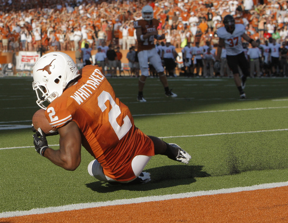 Photo - UT's Fozzy Whittaker (2) makes a catch short of the goal line in the fourth quarter during a college football game between the Oklahoma State University Cowboys (OSU) and the University of Texas Longhorns (UT) at Darrell K Royal-Texas Memorial Stadium in Austin, Texas, Saturday, Oct. 15, 2011. OSU won, 38-26. Photo by Nate Billings, The Oklahoman