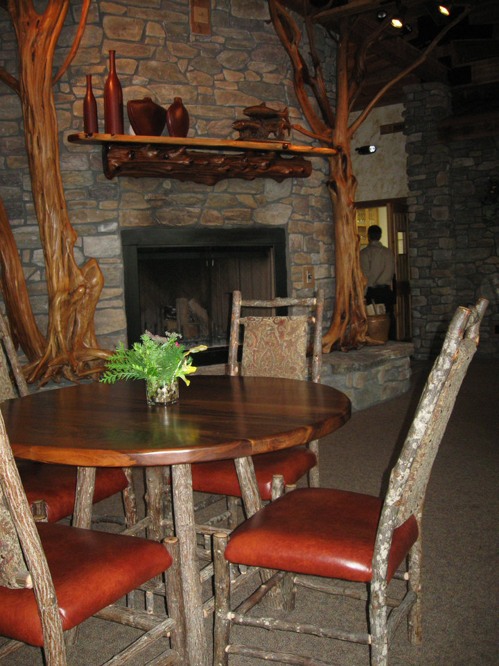 Photo - With polished drifwood and other accents, the lodge's dining room parallels the rustic elegance found outdoors. PHOTO BY PAULA BURKES, THE OKLAHOMAN