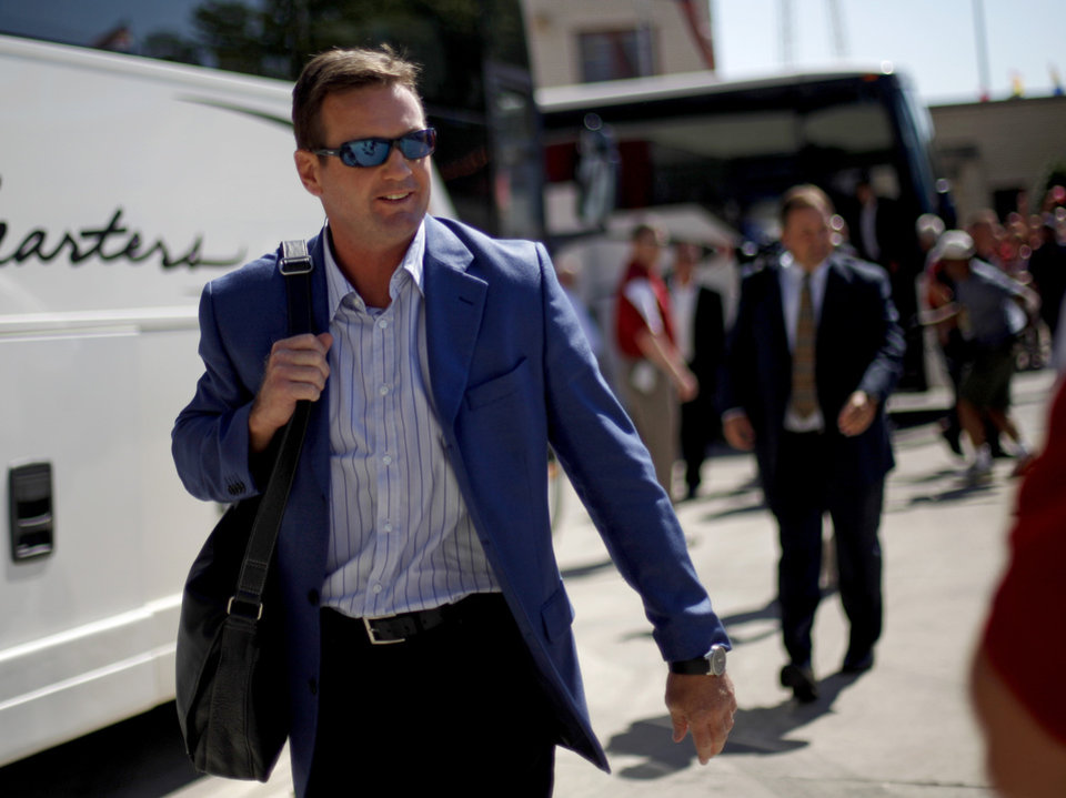 Photo - OU coach Bob Stoops arrives before the Red River Rivalry college football game between the University of Oklahoma Sooners (OU) and the University of Texas Longhorns (UT) at the Cotton Bowl on Saturday, Oct. 2, 2010, in Dallas, Texas.   Photo by Bryan Terry, The Oklahoman