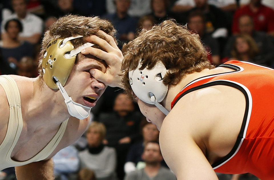Photo - OSU's Alex Dieringer, right, wrestles Minnesota's Dylan Ness for the national championship at 157 pounds in the 2014 NCAA Div. I Wrestling Championships at Chesapeake Energy Arena in Oklahoma City, Saturday, March 22, 2014. Photo by Nate Billings, The Oklahoman