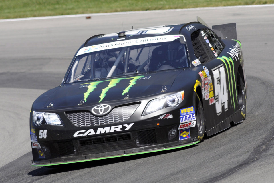 Photo - Sam Hornish Jr.  drives through a corner during practice for the NASCAR Nationwide Series Nationwide Children's Hospital 200 auto race at Mid-Ohio Sports Car Course Friday, Aug. 15, 2014 in Lexington, Ohio. (AP Photo/Tom E. Puskar)