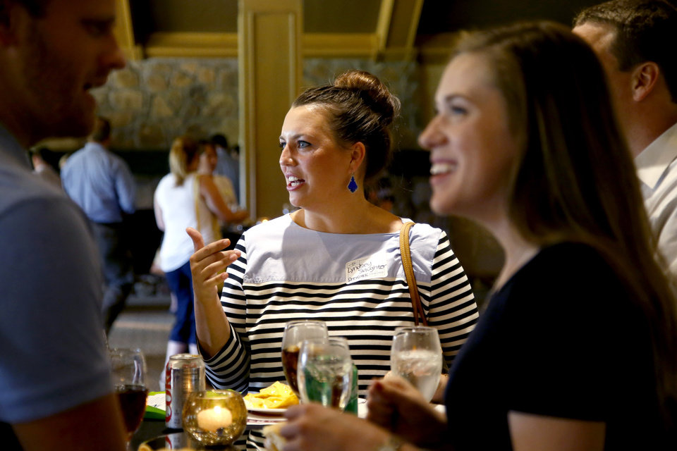 Photo -  Grove Valley Elementary teacher Lyndsey Slaughter talks with others during the Edmond Area Chamber of Commerce reception for new local teachers. [PHOTO BY BRYAN TERRY, THE OKLAHOMAN]