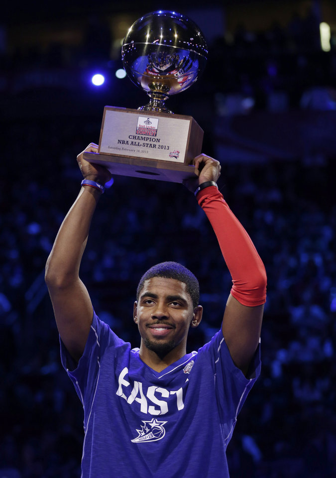 Kyrie Irving of the Cleveland Cavaliers holds up the trophy after winning the 3-point contest during NBA basketball All-Star Saturday Night, Feb. 16, 2013, in Houston. (AP Photo/Eric Gay)