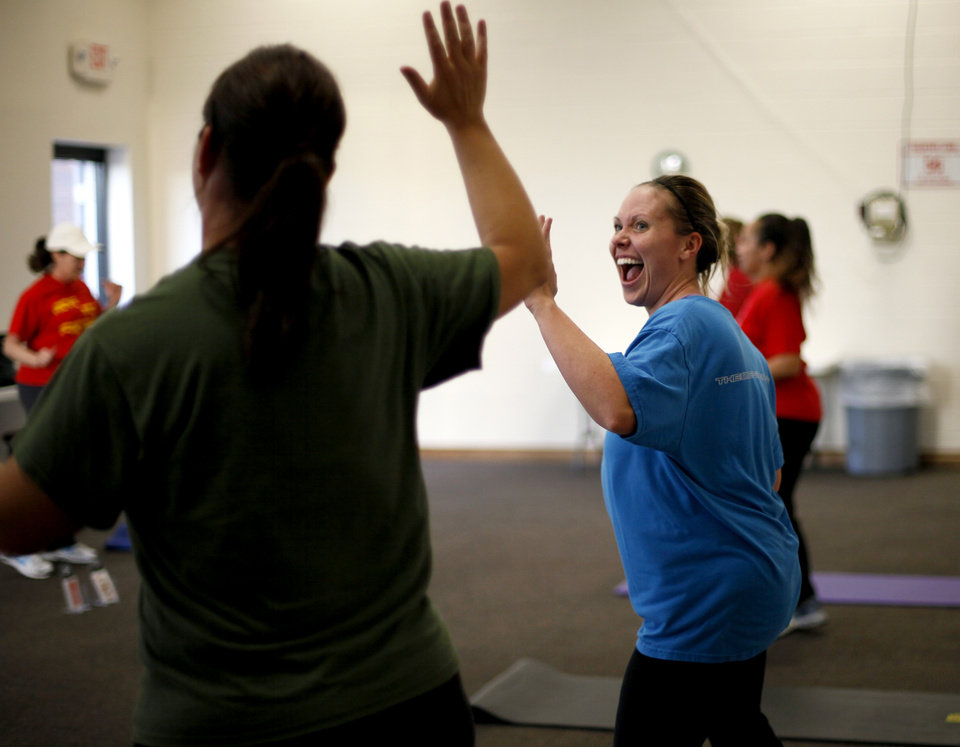 Mandy Dossey laughs as he works out during a Move Into Fitness class in Moore, Okla., Thursday, March 22, 2012. Photo by Bryan Terry, The Oklahoman
