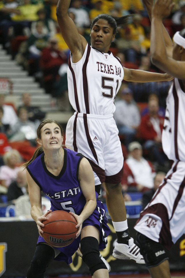 Shalee Lehning drives past Sydney Colson (51) during the 2009 Big 12 Women's Basketball Championship game between Kansas State Wildcats and the Texas A&M Aggies in the Cox Convention Center in Oklahoma City, Oklahoma, on Friday, March 13, 2009. PHOTO BY STEVE SISNEY, THE OKLAHOMAN