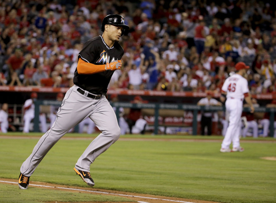 Photo - Miami Marlins' Giancarlo Stanton rounds the bases on a three-run home run against the Los Angeles Angels during the fourth inning of a baseball game in Anaheim, Calif., Monday, Aug. 25, 2014. (AP Photo/Chris Carlson)