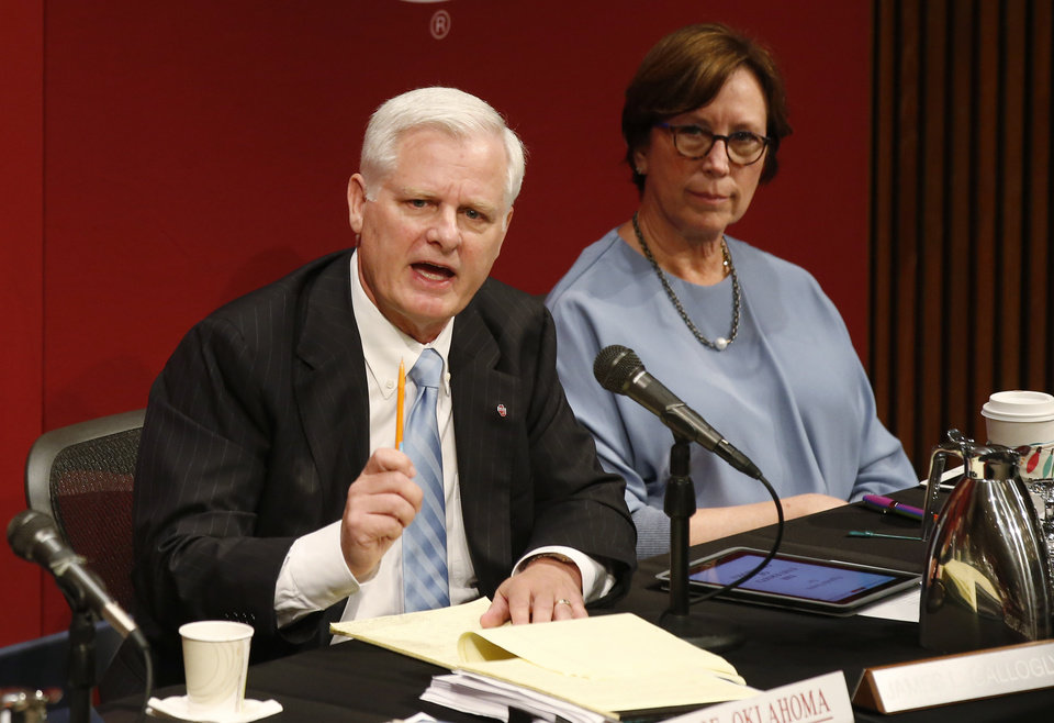 Photo - James Gallogly, President of the University of Oklahoma, speaks at Board of Regents meeting in Oklahoma City, Tuesday, June 19, 2018. At right is Board vice chairman Leslie J. Rainbolt-Forbes, M.D. The Board approved pay for head football coach Lincoln Riley at $25 million over the next five years, including $4.8 million this season. (AP Photo/Sue Ogrocki)