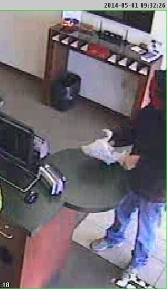 Photo -  An image from a security camera inside The Republic Bank & Trust shows the man who robbed the bank Thursday morning.