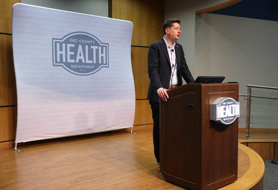 Photo - Oklahoma City Mayor David Holt declares a state of emergency for Oklahoma City after a new case of COVID-19 in the metro area during a press conference at the Oklahoma County Health Department, Sunday March 15, 2020.  [Photo by Doug Hoke/The Oklahoman]