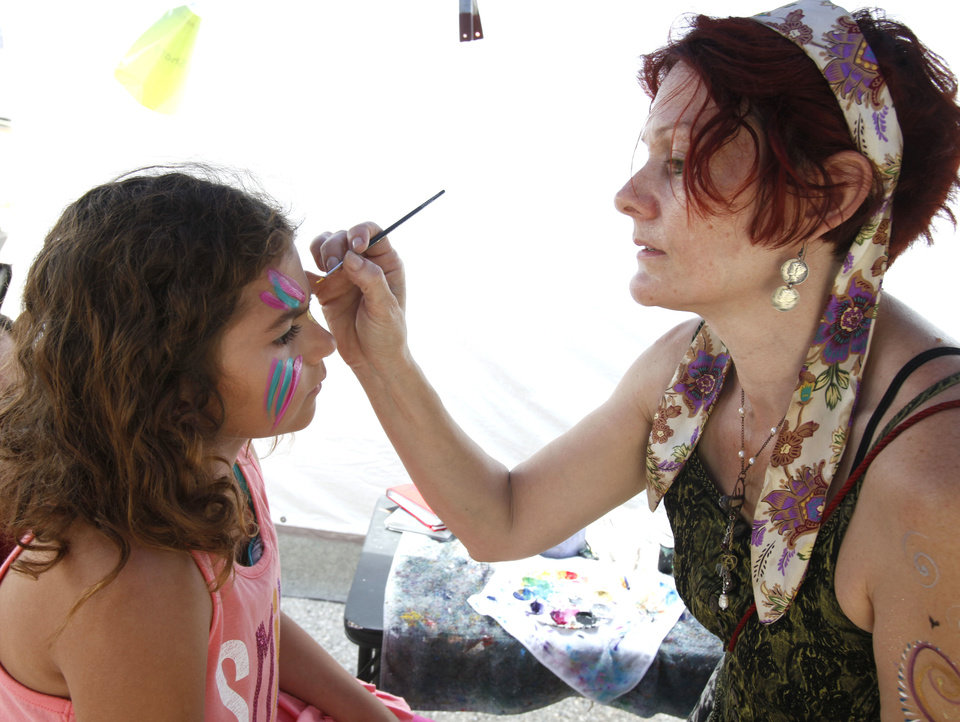 "CHILD / CHILDREN / KIDS / FACE PAINTING / PAINT: Seven-year-old Heaven Autrey has her face painted by Clarissa Sharp, with ""Glassgirl Studios"", during the Paseo Arts Festival in Oklahoma City, OK, Saturday, May 26, 2012,  By Paul Hellstern, The Oklahoman"