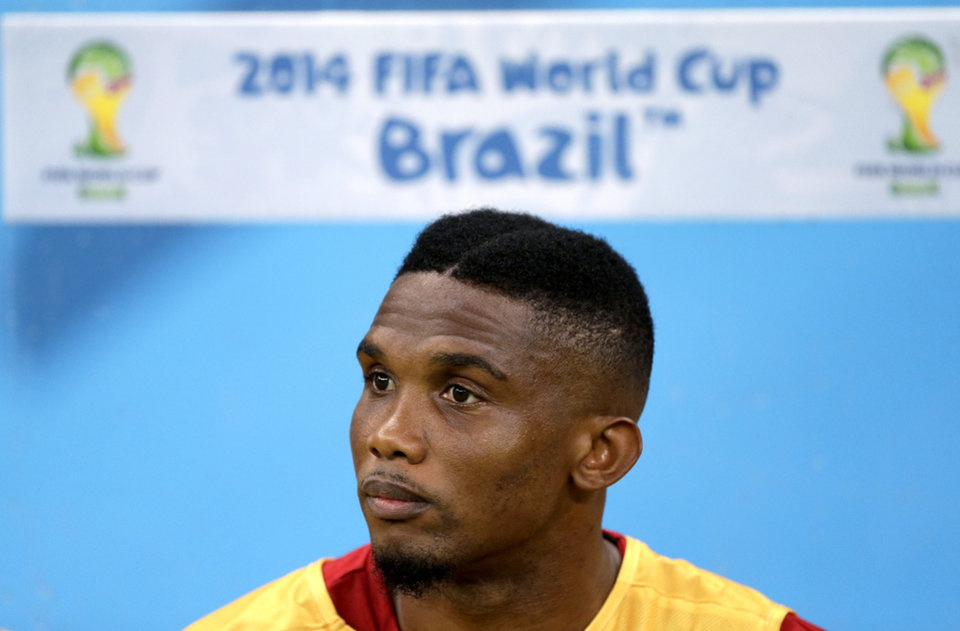 Photo - Cameroon's Samuel Eto'o sits on the bench before the start of the group A World Cup soccer match between Cameroon and Croatia at the Arena da Amazonia in Manaus, Brazil, Wednesday, June 18, 2014. (AP Photo/Themba Hadebe)