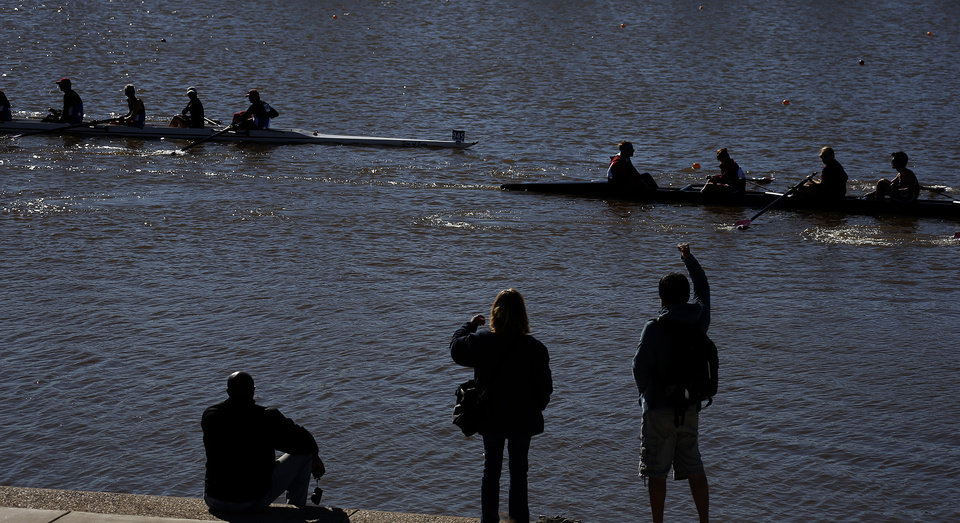 Photo - Spectators cheer rowers as they return to docks on the Oklahoma River during OCU Head of the Oklahoma & USRowing Masters National Head Race Championships, Sunday, Oct. 6, 2013, in Oklahoma City. Photo by Sarah Phipps, The Oklahoman
