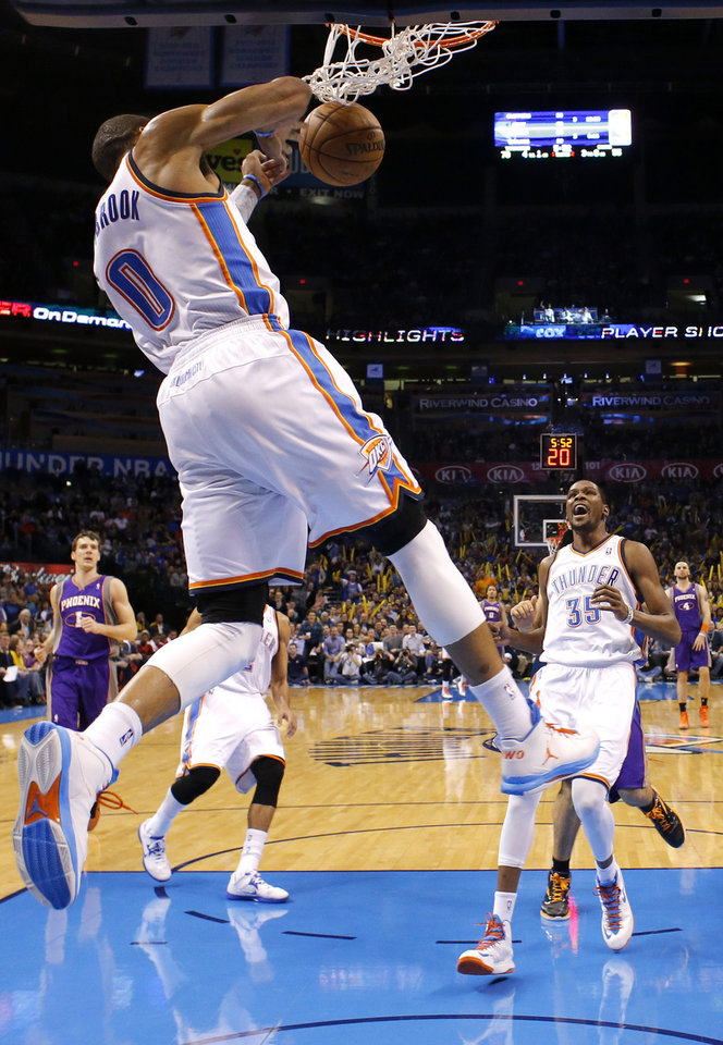 Photo - Oklahoma City's' Kevin Durant (35) celebrates the dunk of  Russell Westbrook (0) during the NBA game between the Oklahoma City Thunder and the Phoenix Suns at theChesapeake Energy Arena, Friday, Feb. 8, 2013.Photo by Sarah Phipps, The Oklahoman