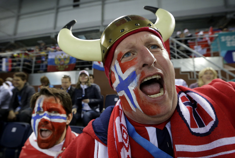 Photo - Norwegian curling fan Rune Eikeland cheers during men's curling competition between his homeland and China at the 2014 Winter Olympics, Friday, Feb. 14, 2014, in Sochi, Russia. (AP Photo/Robert F. Bukaty)
